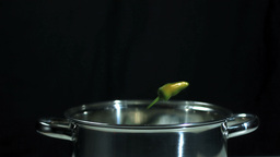 Jalapeno chili falling into a pot Stock Video Footage