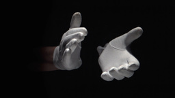 Gloved hands clapping on black background close up Footage