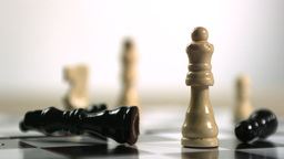 Black chess piece falling over Stock Video Footage