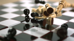 Chess pieces crashing onto board Live Action