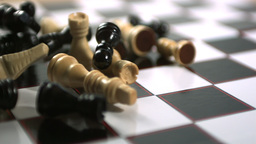 Chess pieces thrown across the board Footage