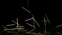 Toothpicks falling on black background Footage