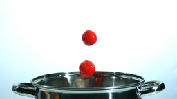 Cherry tomatoes falling in a pot Footage