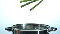 Asparagus falling into a saucepan Stock Video Footage