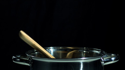 Wooden spoon falling in pot Footage