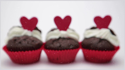 Three valentines cupcakes on white background clos Footage