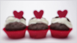 Three valentines cupcakes on white background clos Stock Video Footage
