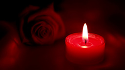 Candle flickering beside red roses and going out Stock Video Footage