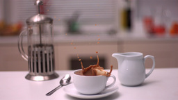 Sugar cube falling in coffee Footage