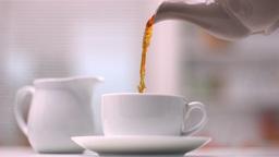 Teapot pouring tea Footage