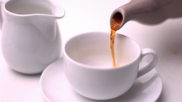 Teapot pouring tea into a cup Stock Video Footage