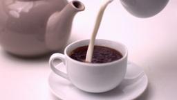 Milk pouring into tea Footage