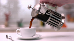 Coffee being poured from cafetiere Stock Video Footage