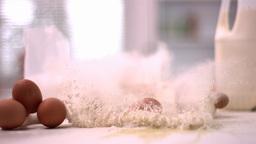 Egg smashing in mound of flour Footage