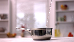 Water Pouring Into Pot In Kitchen stock footage