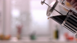 Cafetiere pouring coffee into cup Stock Video Footage
