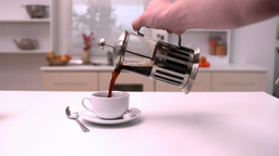 Man pouring coffee into cup Footage