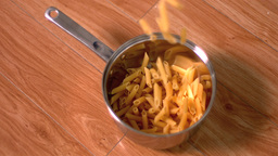 Penne falling into pot Stock Video Footage