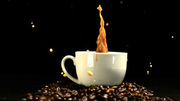 Sugar cube falling in coffee cup and splashing Stock Video Footage