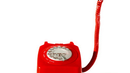 Receiver falling onto red dial phone on white back Stock Video Footage