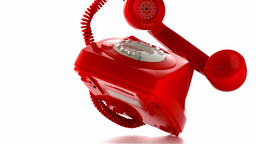 Red dial phone falling and bouncing Live Action