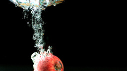 Apple falling into water and floating Footage