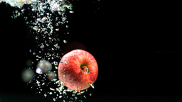 Apple falling into water and floating Stock Video Footage