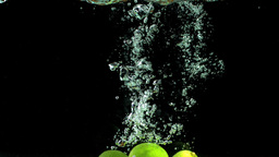 Three limes falling into water Footage