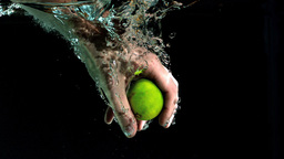 Hand grabbing lime from water Stock Video Footage