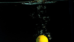 Hand taking lemon from water Footage