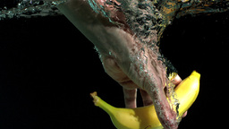 Hand taking banana from water Stock Video Footage