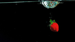 Strawberry falling in water Stock Video Footage