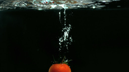 Tomato falling into water Stock Video Footage