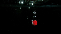 Raspberry dropping into water Footage