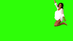Girl in white dress jumping on green screen Stock Video Footage