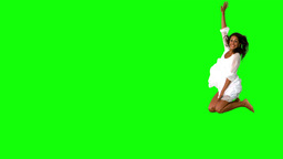 Girl in white dress jumping on green screen with l Footage