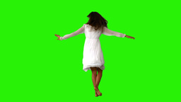 Girl in white dress twirling on green screen Stock Video Footage