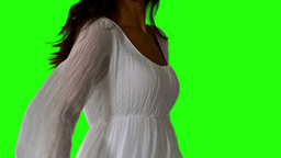 Girl in white dress turning on green screen close  Footage