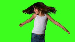 Little girl twirling on green screen Footage