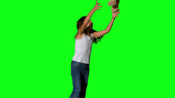 Little girl throwing and catching teddy on green s Stock Video Footage