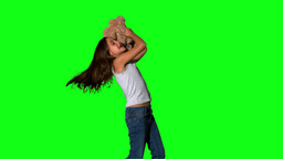 Little girl throwing and catching teddy on green screen Stock Video Footage