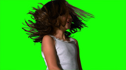 Little girl tossing her hair on green screen Footage