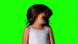 Little girl shaking her hair on green screen Footage