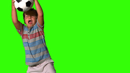 Little boy catching football on green screen Stock Video Footage