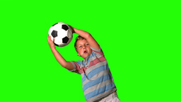 Boy catching football on green screen Footage