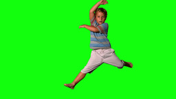 Boy jumping up on green screen Footage