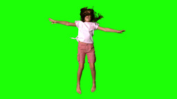 Girl jumping up on green screen Footage