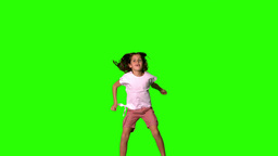 Girl jumping up and down on green screen Stock Video Footage