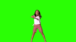 Girl jumping up and down on green screen Footage