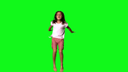 Happy girl jumping on green screen Stock Video Footage